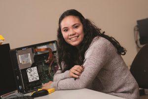 Maya at her computer